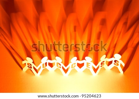 Success of paper doll people holding hands - stock photo