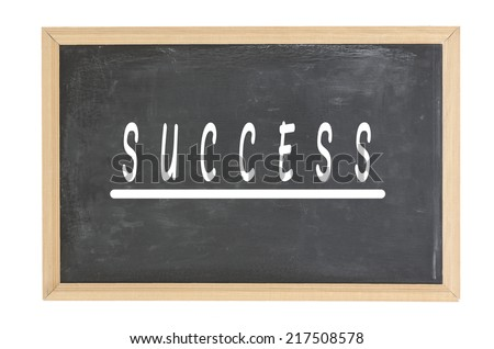 Success on A chalk board with chalk stains - stock photo