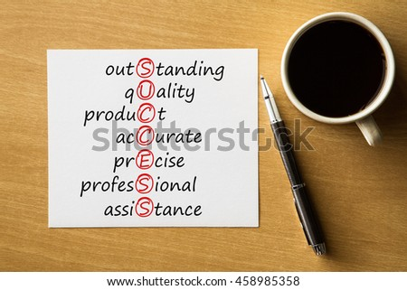 SUCCESS outstanding, quality, product, accurate, precise, professional, assistance - handwriting on notebook with cup of coffee and pen, acronym business concept