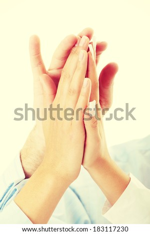 Success, partnership and teamwork concept. Hands of a successful business team on a white background - stock photo