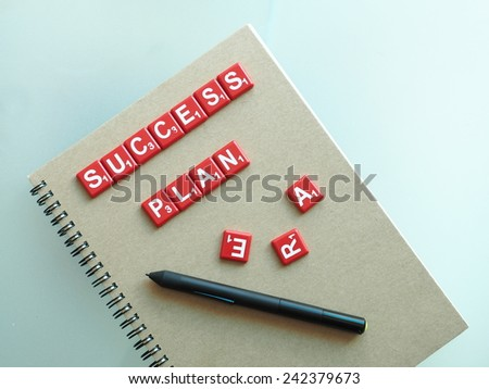 success plan letter and pen on the notebook