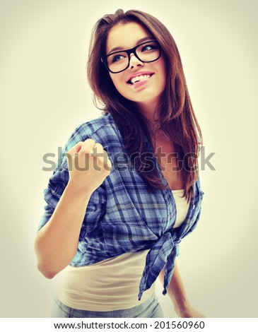 Success.Portrait of excited girl , raising hands and laughing at camera. - stock photo