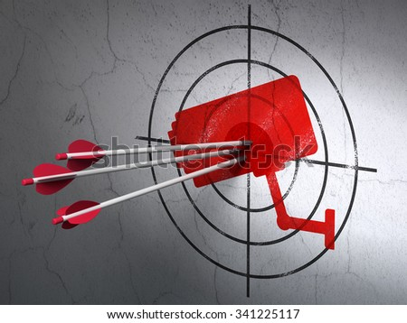 Success protection concept: arrows hitting the center of Red Cctv Camera target on wall background