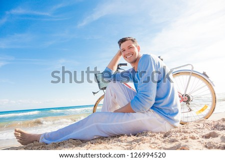 success relaxing man on bike - stock photo