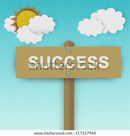 Success Road Sign For Business Solution Concept Made From Recycle Paper With Beautiful Sun and White Cloud in Blue Sky Background - stock photo
