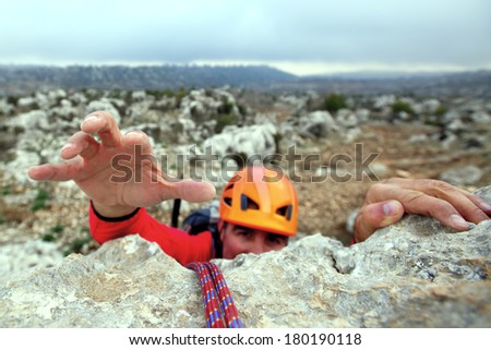 Success. Rock climber rappelling - stock photo