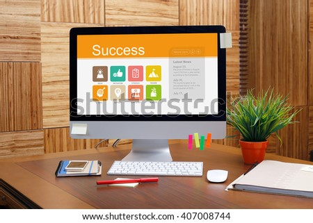 Success screen on the workplace - stock photo
