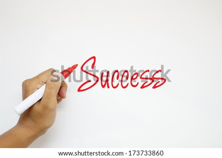 Success sign on whiteboard - stock photo