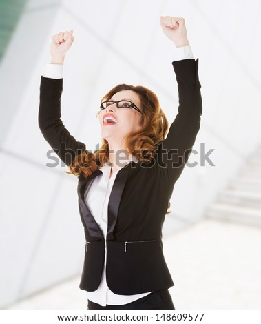 Success, winner businesswoman with fists up