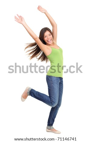 Success woman dancing and celebrating standing in full length isolated on white background. Natural beauty having fun. Mixed-race Asian Chinese / white Caucasian female model. - stock photo