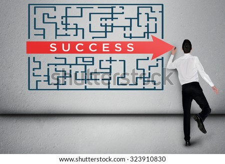 Success word maze and business man thinking solution - stock photo