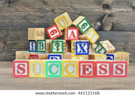 Success word on wooden table
