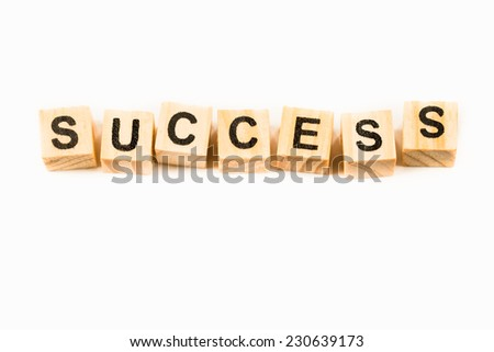 Success words made out of alphabet wood pieces isolated on white