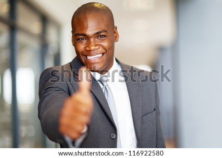 successful african american businessman thumb up - stock photo