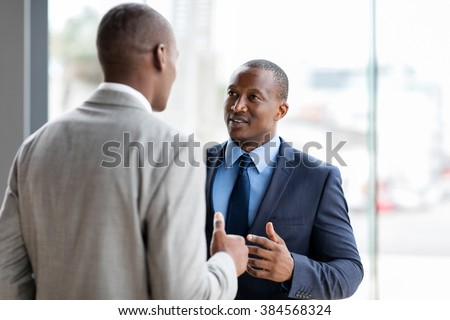 successful african american businessmen having conversation in office - stock photo