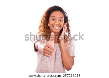 Successful african american woman making thumbs up gesture - Black people