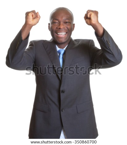 Successful african businessman in a dark suit - stock photo