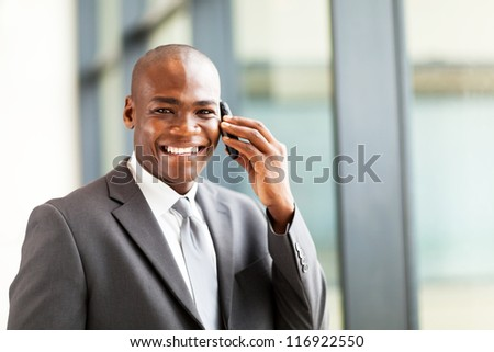 successful african businessman talking on cell phone - stock photo