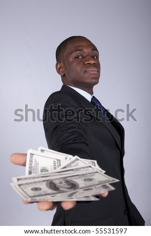 Successful and wealthy african businessman showing you money - stock photo