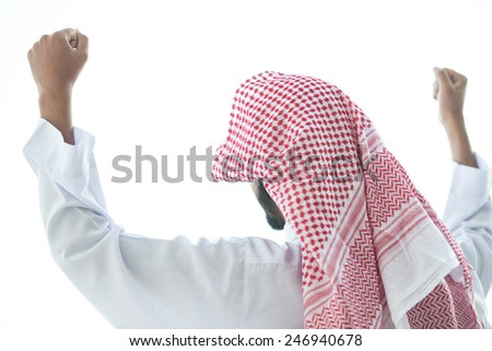 Successful Arabic man celebrating win - stock photo