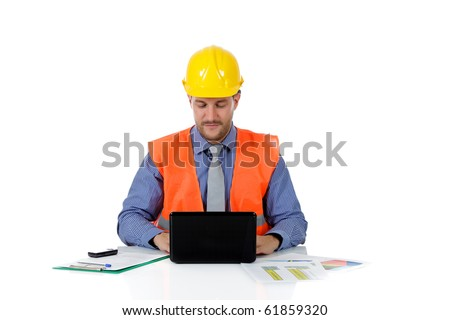 Successful attractive caucasian man architect with safety helmet in the office and working with laptop. Studio shot. White background. - stock photo