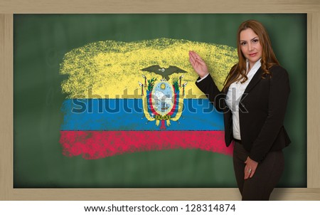 Successful, beautiful and confident woman showing flag of ecuador on blackboard for marketing research, presentation and tourist advertising - stock photo