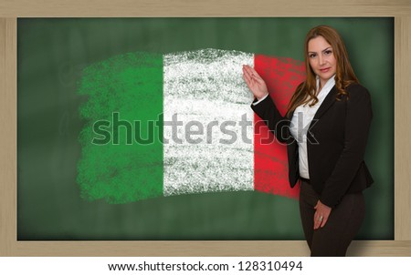 Successful, beautiful and confident woman showing flag of italy on blackboard for marketing research, presentation and tourist advertising - stock photo