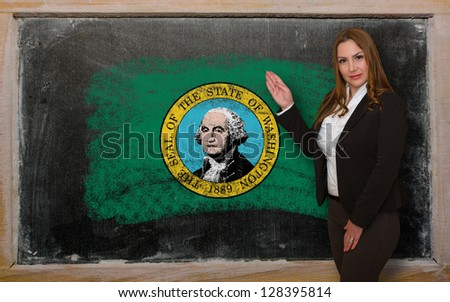 Successful, beautiful and confident woman showing flag of washington on blackboard for marketing research, presentation and tourist advertising - stock photo