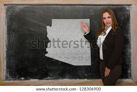 Successful, beautiful and confident young woman showing map of arizona on blackboard for presentation, marketing research and tourist advertising