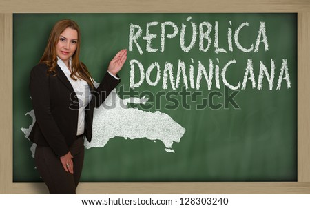 Successful, beautiful and confident young woman showing map of dominican on blackboard for presentation, marketing research and tourist advertising - stock photo