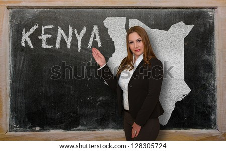 Successful, beautiful and confident young woman showing map of kenya on blackboard for presentation, marketing research and tourist advertising - stock photo