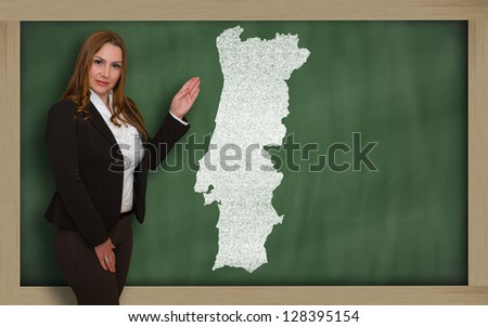 Successful, beautiful and confident young woman showing map of portugal on blackboard for presentation, marketing research and tourist advertising