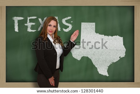 Successful, beautiful and confident young woman showing map of texas on blackboard for presentation, marketing research and tourist advertising - stock photo