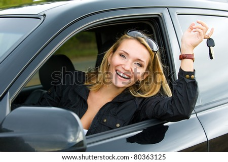 successful beautiful happy woman in the new car with keys - outdoors