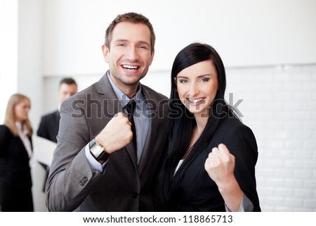 Successful business couple smiling
