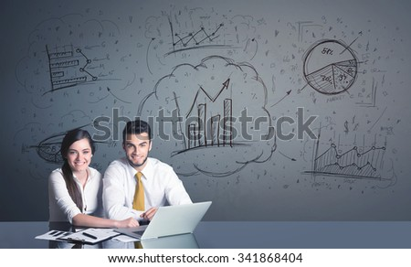 Successful business couple with all kind of hand-drawn business diagrams in background  - stock photo