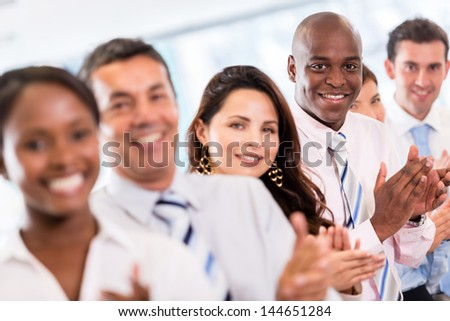Successful business group applauding after a presentation - stock photo