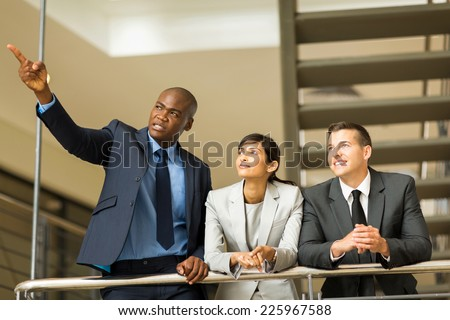 successful business group discussing work in modern office - stock photo