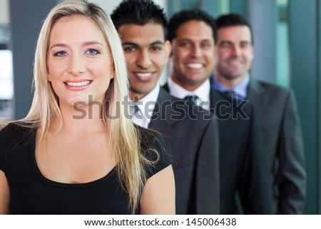 successful business group in a row smiling - stock photo