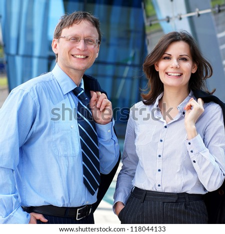 Successful business man and business woman standing over the modern background