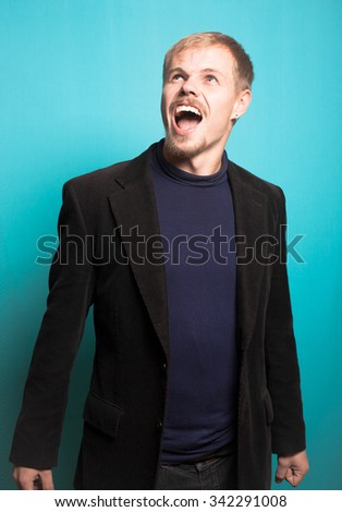 successful business man disgusted with beard and mustache, office style studio photo isolated on a blue background - stock photo