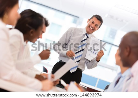 Successful business man in a meeting making presentation - stock photo