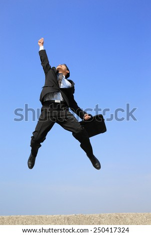 successful business man jump and run with blue sky background, full length, asian male - stock photo