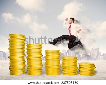 Successful business man jumping up on gold coin money concept - stock photo