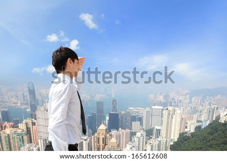 Successful business man looking away with city background, asian, hong kong - stock photo