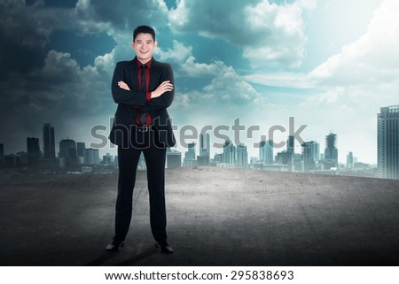 Successful business man on the rooftop. Business success concept