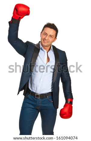 Successful business man raising hand in boxing gloves isolated on white background - stock photo