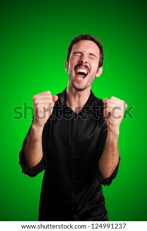 successful business man screaming on blue background