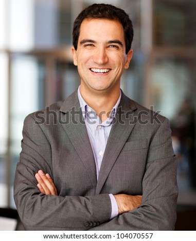 Successful business man smiling and looking friendly