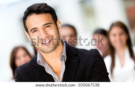 Successful business man smiling at the office - stock photo